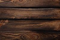 Texture of boards of dark old brown wood