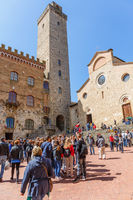 People at Piazza Duomo in San Gimignano, a Italian city