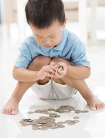 Child saving coins