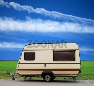 Vintage caravan on a parking lot with blue sky