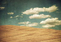 vintage style landscape, clouds over the hills