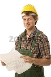 Confident handyman holding floor plan