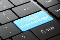 Law concept: Legal Proceedings on computer keyboard background