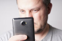 man taking selfie photo with smartphone