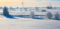 Winter landscape with wind turbines