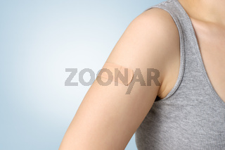 Plaster on female arm