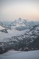Sunset panorama of the elbrus and part of the Caucasian ridge