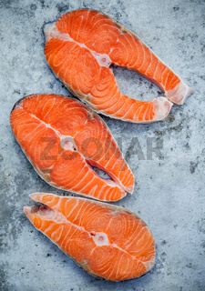 Fresh salmon fillet sliced flat lay on shabby metal background. Fresh salmon fillet sliced tempts buyers at fresh seafood stall.