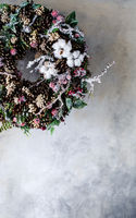 Christmas wreath with cones and berries and leaves and cotton