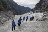 Tourists hiking on Franz Josef Glacier, New Zealand