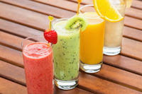 Four smoothie on wooden table