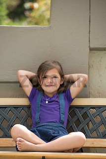 Little Girl on Outside Bench
