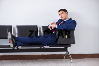 Man wairing to boarding in airport lounge room