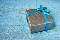 Gift box with blue ribbon