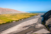 Valley of Ocona River as it flows into the Pacific ocean in the Arequipa Region, Peru