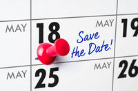 Wall calendar with a red pin - May 18