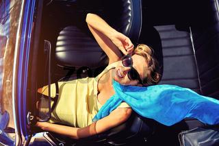 Attractive woman sitting in retro car
