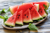 Juicy watermelon slices on a tray.