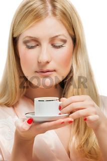 Beauriful girl in nightgown drinking coffee