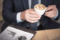 Closeup of senior business man hands holding a cup of coffee