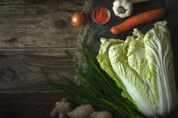 Chinese cabbage, carrot, chili for kimchi on old boards