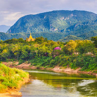 River, temple and mountains. Beautiful landscape. Laos.