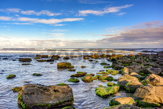 Stones and seawater with horizon line