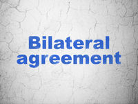 Insurance concept: Bilateral Agreement on wall background