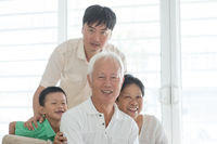 Portrait of Asian family at home