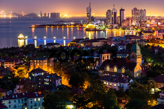 Qingdao Bay and the Lutheran church seen from Signal Park at night, Qingdao.