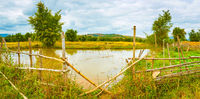 Beautiful rural landscape, pond on the foreground. Laos. Panorama