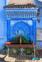 Blue fountain in medina of Chefchaouen