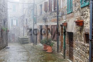 Misty alley in an Italian village
