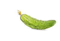 Fresh green cucumber with yellow flower isolated over white