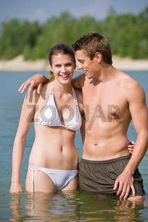Couple in swimwear enjoy water and sun