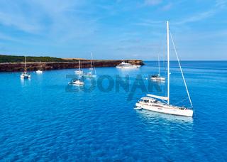 Early morning in in Formentera. Sailboats at Cala Saona bay. Balearic Islands. Spain