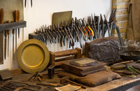 Collection of vintage woodworking tools on a rough workbench