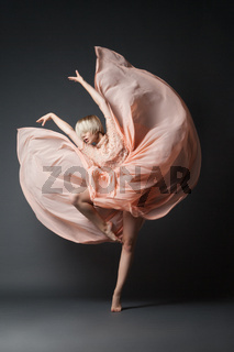 Woman dancing in chiffon dress
