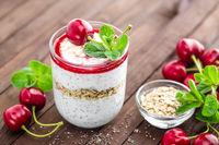 Fresh cherry yogurt with oats and chia seeds, healthy breakfast