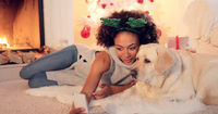 Cute young woman taking a selfie with her dog