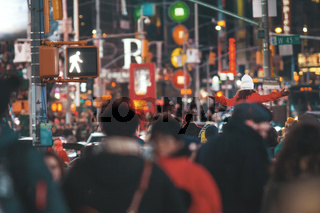 A crowd moves through Times Square - a lot of people