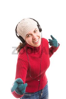 Young woman listening musing and dancing happy