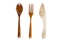 Wooden fork, knife and spoon on white background