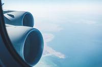Airliner jet engines and coastal landscape