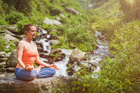 Woman in Padmasana outdoors