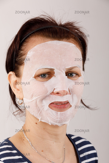 housewife woman with a sheet mask on her face