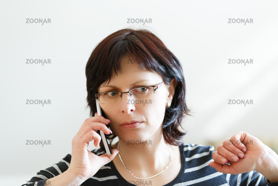 tired middle-aged woman call by phone