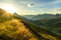 Beautiful sunrise and layered mountain silhouettes in early morning. Lechtal and Allgau Alps, Bavaria and Austria.