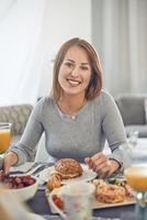Happy attractive woman enjoying a sandwich