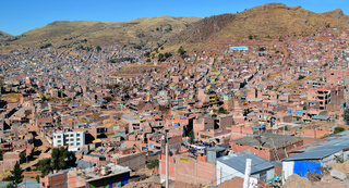 Top view on roofs and streets of Cusco town